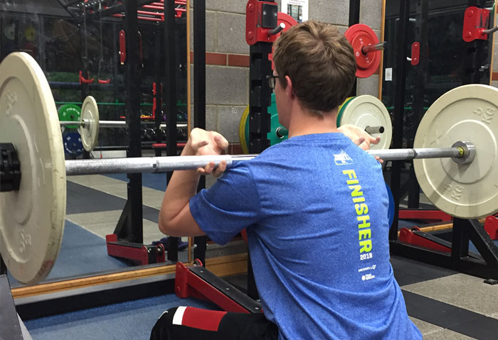Client learning front-racked squat (light load - barbell)