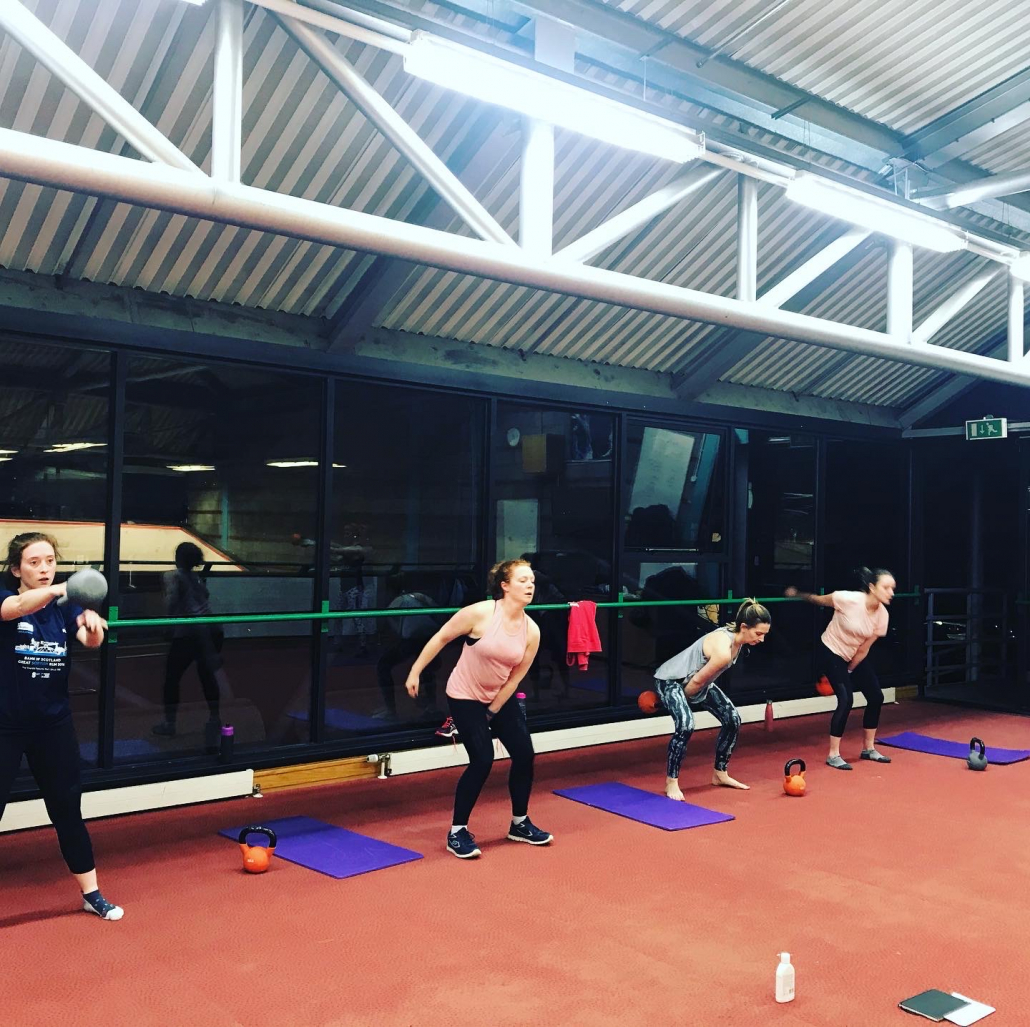 group kettlebell training action