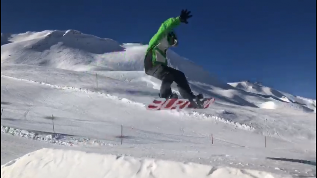 Nick snowboarding