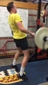 action shot of client weightlifting