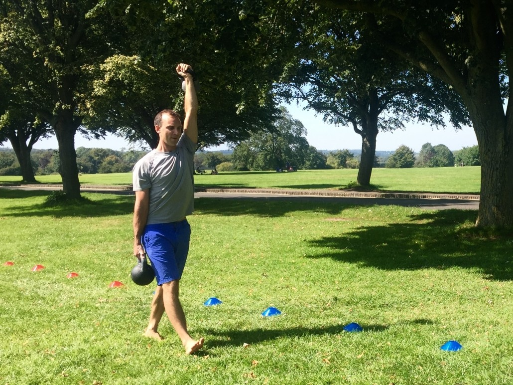 carrying exercise with two kettlebells